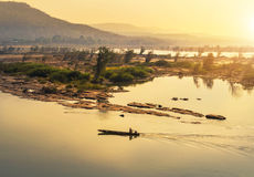 Wooden fishing boat sailing in mekong river on sunrise at border of thailand and laos Royalty Free Stock Photography