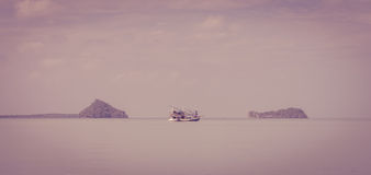 Wooden fishing boat sailing in sea Stock Images