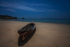 Wooden fishing boat on a sand beach at night Royalty Free Stock Photos