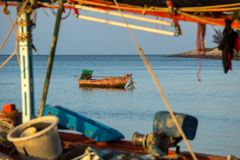 Wooden fishing boat in the sea Stock Images