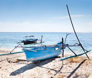 Wooden fishing boat on the shore Stock Photo