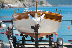 Wooden fishing boat stands on the coast Royalty Free Stock Image