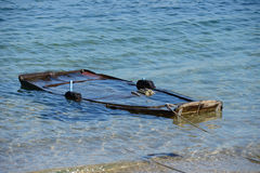 Wooden fishing boat submerged in water. Image of wooden fishing boat submerged in water Stock Photo