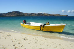 Wooden fishing boat on the white beach Royalty Free Stock Image