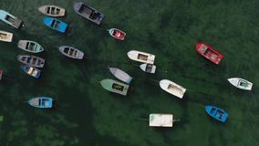Wooden fishing boats anchored in the sea, top view. From drone stock footage