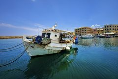 Wooden fishing boats in the beautiful small harbour Rethymno of Crete island in Greece Stock Images