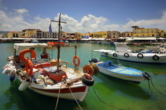 Wooden fishing boats in the beautiful small harbour Rethymno of Crete island in Greece Royalty Free Stock Photos