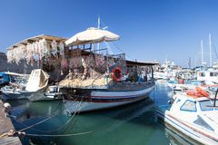 Wooden fishing boats in Greece. Wooden fishing boats  in the beautiful small harbour Rhodos island, Greece Stock Photo