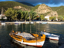Wooden Fishing Boats in Greek Village Harbour Royalty Free Stock Photography