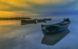 Wooden fishing boats on lake Royalty Free Stock Image