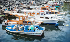 Wooden fishing boats moored in Avcilar port. Wooden fishing boats moored in small port of Avcilar, district of Istanbul, Turkey Royalty Free Stock Images
