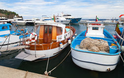 Wooden fishing boats moored in Lacco Ameno port Royalty Free Stock Photography