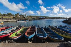 Wooden fishing boats in the natural port of Hanga Roa stock image