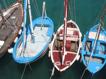 Wooden fishing boats, Puglia, Italy. Fishing boats in small marina in fishing village Tricase Porto in Southern Italy, during hot summer day Stock Photography