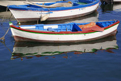 Wooden fishing boats on the sea. Old multicolored fishing boats on the sea in Bari harbor Royalty Free Stock Photo