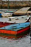 Wooden fishing boats tied to a dock Stock Photography