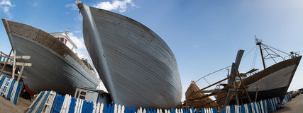 Wooden fishing boats under construction in shipyard, Morocco Royalty Free Stock Photos