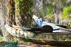 Wooden fishing canoe Stock Photo