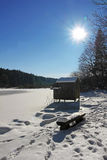 Wooden fishing hut and snow covered lake. In winter Royalty Free Stock Photography