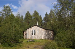 Wooden fishing lodge in the forest. Royalty Free Stock Images