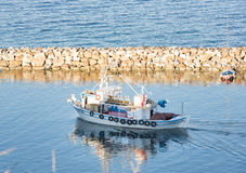 Wooden fishing motor boat Stock Photos