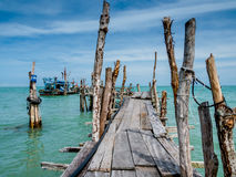 Wooden Fishing Pier or Jetty on Tropical Island Stock Images