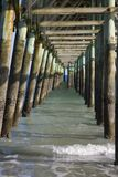 Wooden fishing pier underside Royalty Free Stock Image