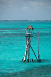 Wooden fishing tower hut / cabin on the Mexican island called Isla Mujeres Island of the Women. Wooden fishing tower hut / cabin in the Caribbean sea on the Royalty Free Stock Image