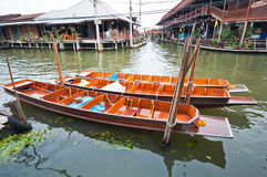 Wooden flat boats in the river at Damoen Saduak floating market Royalty Free Stock Photo