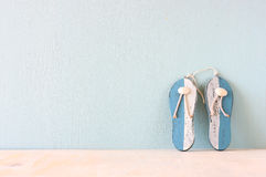 Wooden flip flops over white textured background Royalty Free Stock Images