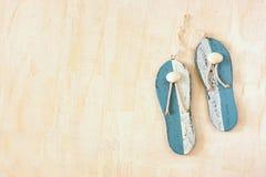 Wooden flip flops over white textured background. Stock Photo