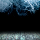 Wooden floor. Against the backdrop of clouds of smoke Stock Images