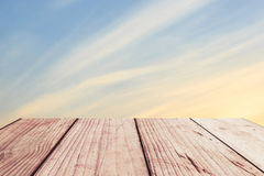 Wooden floor background aspiring to soft color sky Royalty Free Stock Images