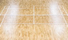 Wooden floor badminton court and nets. Wooden floor of sports ha. Ll with marking lines line on wooden floor indoor, gym court royalty free stock photo
