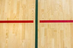 Wooden floor badminton, futsal, handball, volleyball, football, soccer court. Wooden floor of sports hall with marking red lines o. N wooden floor indoor, gym stock photo