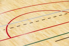 Wooden floor badminton, futsal, handball, volleyball, football, soccer court. Wooden floor of sports hall with marking red lines o. N wooden floor indoor, gym royalty free stock images