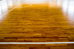 Wooden floor basketball court royalty free stock photography