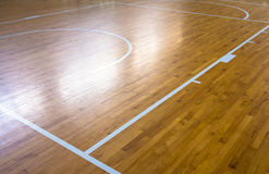 Wooden floor basketball court Stock Images