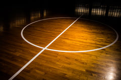 Wooden floor basketball court. With light effect Stock Image