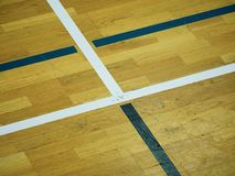 Wooden floor Basketball Court.  Sporting hall with strong lightning, sratches Stock Photo