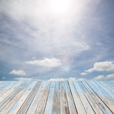 Wooden floor with beautiful blue sky scenery for background Royalty Free Stock Photography