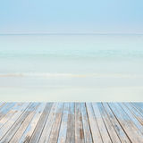 Wooden floor with beautiful ocean and blue sky retro pastel  sce Stock Photos