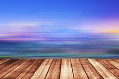 Wooden floor with beautiful ocean and blue sky scenery Stock Photos