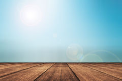 Wooden floor with beautiful ocean and blue sky scenery Stock Photography