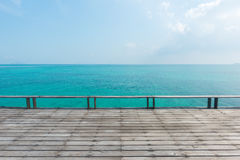 Wooden floor with beautiful ocean. And blue sky scenery Stock Images