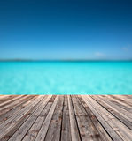 Wooden floor and blue sea Royalty Free Stock Image