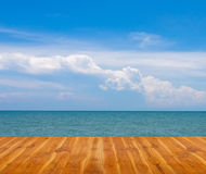 Wooden floor with blue sea and sky. stock photo