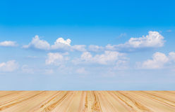 Wooden floor with blue sky background. Brown Wooden floor with blue sky background Stock Photo