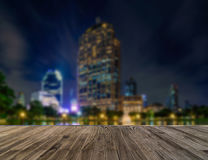 Wooden floor with blurred abstract background of Bangkok city at night time Royalty Free Stock Image