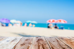 Wooden floor and blurred beach atmosphere Royalty Free Stock Photo
